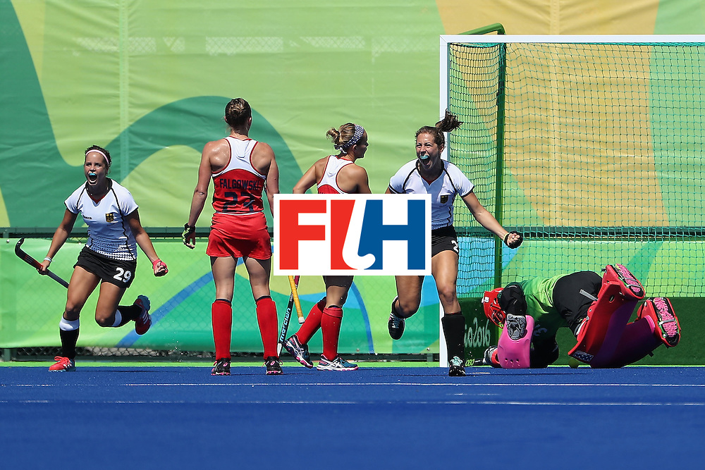 RIO DE JANEIRO, BRAZIL - AUGUST 15:  Marie Mavers #23 of Germany celebrates with Pia-Sophie Oldhafer #29 after scoring a first half goal past goalkeeper Jackie Briggs #31 of United States during the quarter final hockey game on Day 10 of the Rio 2016 Olympic Games at the Olympic Hockey Centre on August 15, 2016 in Rio de Janeiro, Brazil.  (Photo by Christian Petersen/Getty Images)