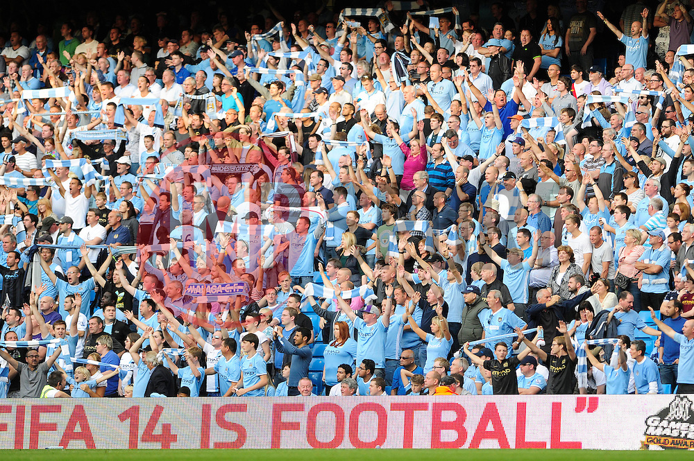 Manchester City fans - Photo mandatory by-line: Dougie Allward/JMP - Tel: Mobile: 07966 386802 22/09/2013 - SPORT - FOOTBALL - City of Manchester Stadium - Manchester - Manchester City V Manchester United - Barclays Premier League