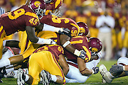 University of Southern California Trojan linebacker Thomas Williams and defensive end Lawrence Jackson tackle a Arkansas Razorback running back during a 70 to 17 win over the Razorbacks on September 17, 2005 at Los Angeles Memorial Coliseum in Los Angeles, California. .Mandatory Credit: Wesley Hitt/Icon SMI