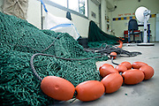 Israel, Coastal Plains, Kibbutz Maagan Michael the Fishery fishing net being mended