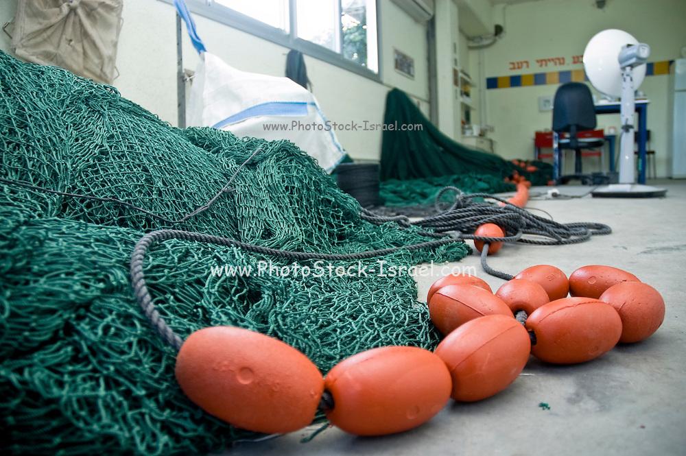 Israel, Coastal Plains, Kibbutz Maagan Michael the Fishery fishing net being mended