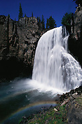 Rainbow Falls at Devils' Postpile National Monument. Devil's Postpile National Monument was established in 1911 by presidential proclamation. It protects and preserves the Devils Postpile formation, the 101-foot high Rainbow Falls, and pristine mountain scenery. The Devils Postpile formation is a rare sight in the geologic world and ranks as one of the world's finest examples of columnar basalt. Its columns tower 60 feet high and display an unusual symmetry. Another wonder is in store just downstream from the Postpile at Rainbow Falls, once called ?a gem unique and worthy of its name.? When the sun is overhead, a bright rainbow highlights the spectacular falls. Route 395: Eastern Sierra Nevada Mountains of California.