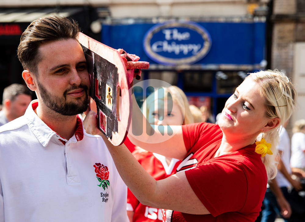 An England fan having face paint applied<br /> <br /> Photographer Simon King/Replay Images<br /> <br /> Friendly - Wales v England - Saturday 17th August 2019 - Principality Stadium - Cardiff<br /> <br /> World Copyright © Replay Images . All rights reserved. info@replayimages.co.uk - http://replayimages.co.uk