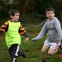 William Halpin releases the ball before Paul Kearney causes problems at the East Clare Eagles rugby training in Tulla on Saturday morning.<br /><br />Photograph by Yvonne Vaughan.