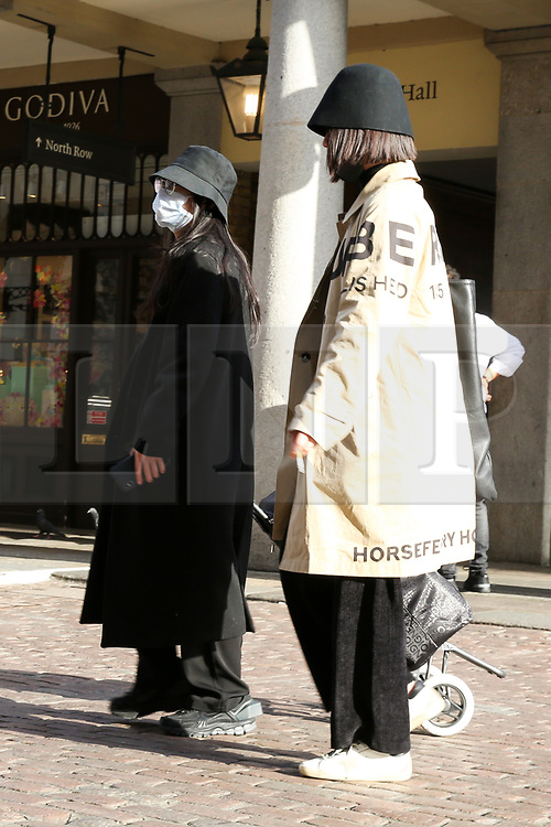 © Licensed to London News Pictures. 13/03/2020. London, UK. A woman wearing a face mask at a nearly empty Covent Garden as members of the public are staying away from crowded area amid an increased number of Coronavirus (COVID-19) cases in the UK. A tube drive has been tested positive for the virus. 798 cases have been tested positive and ten patients have died from the virus in the UK. Photo credit: Dinendra Haria/LNP