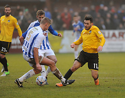 Bristol Rovers' Jake Gosling is challenged by Nuneaton Town's Gareth Dean - Photo mandatory by-line: Neil Brookman/JMP - Mobile: 07966 386802 - 04/01/2015 - SPORT - football - Nuneaton - James Parnell Stadium - Nuneaton Town v Bristol Rovers - Vanarama Conference