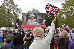 © Licensed to London News Pictures. 05/06/2012. LONDON, UK. Spectators gather on the route of the royal carriage procession through central London as part of the Royal Jubilee celebrations. Great Britain is celebrating the 60th  anniversary of the countries Monarch HRH Queen Elizabeth II accession to the throne this weekend Photo credit : Cliff Hide/ LNP