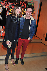 ALEXA CHUNG and NICK GRIMSHAW at a party to celebrate the switching on of the Christmas Lights at the Stella McCartney store, Bruton Street, London on 29th November 2011.