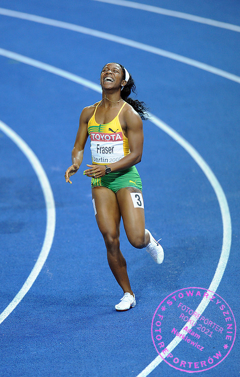 SHELLY ANN FRASER (JAMAICA) CELEBRATES WINNING THE GOLD MEDAL IN 100 METERS WOMEN ON THE OLYMPIC STADION ( OLIMPIASTADION ) DURING 12TH IAAF WORLD CHAMPIONSHIPS IN ATHLETICS BERLIN 2009..BERLIN , GERMANY , AUGUST 17, 2009..( PHOTO BY ADAM NURKIEWICZ / MEDIASPORT )..PICTURE ALSO AVAIBLE IN RAW OR TIFF FORMAT ON SPECIAL REQUEST.