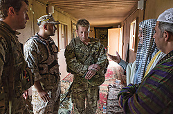 Image shows, LtoR, Captain James Gilbert and Staff Sargeant Neil Bunting, 77 Brigade talking to mock civilian population during an exercise with the United States Marine Corps and Army at Quantico Marine Corps Base, Quantico Virginia. <br /> <br /> 19/05/2015<br /> <br /> Elements of 77X are working with American troops on Combined Unit Exercise (CUX) 15.2 - a 3 week exercise meant to test Marine Corps Information Operations Centre (MCIOC) personnel in a variety of Information<br /> Operation techniques. <br /> <br /> <br /> Credit should read: Cpl Mark Larner RY