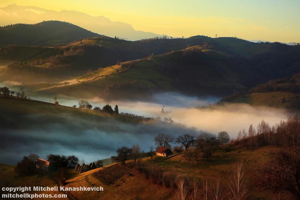 A foggy autumn (fall) morning in a Romanian village