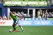 Nouhou Tolo #5 of Seattle Sounders and Brandon Bye #15 of New England Revolution battle for possession during a MLS soccer match on Saturday, Aug. 10, 2019, in Seattle. The teams played tp a 3-3 tie. (Alika Jenner/Image of Sport)