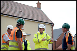 Image ©Licensed to i-Images Picture Agency. 27/09/2014. Didcot, United Kingdom. The Prime Minister David Cameron meets builders during a housing visit to Great Western Park, Didcot, Oxfordshire. Ahead of the start of the 2014 Conservative Party Conference in Birmingham. Picture by Andrew Parsons / i-Images