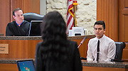 Milby High School student Geovanni Ventura, right, participates in a mock trail at the Harris County Civil Courthouse, July 30, 2014.