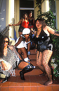 Girls pose on a doorstep, Notting Hill Carnival, 2005.
