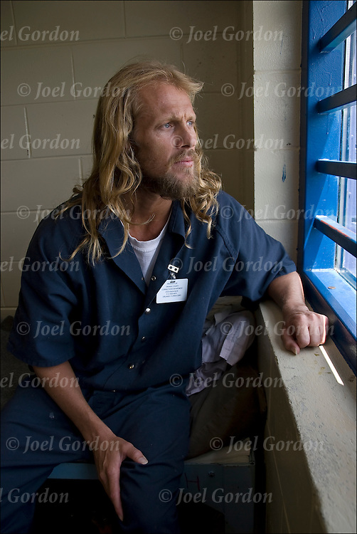Phoenix Facility of the Orange County Jail. Direct Supervision Dormitory. Caucasian inmate sitting on bunk bed looking out window.  What is going on in his mind?  Feeling of hopelessness, depression, being alone or freedom? <br /> <br /> Release #2367