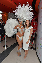 JESSICA ENNIS-HILL and samba dancer at the OMEGA 100 days to Rio Olympics VIP Dinner at Sushi Samba, Heron Tower, 110 Bishopsgate, City of London on 27th April 2016.