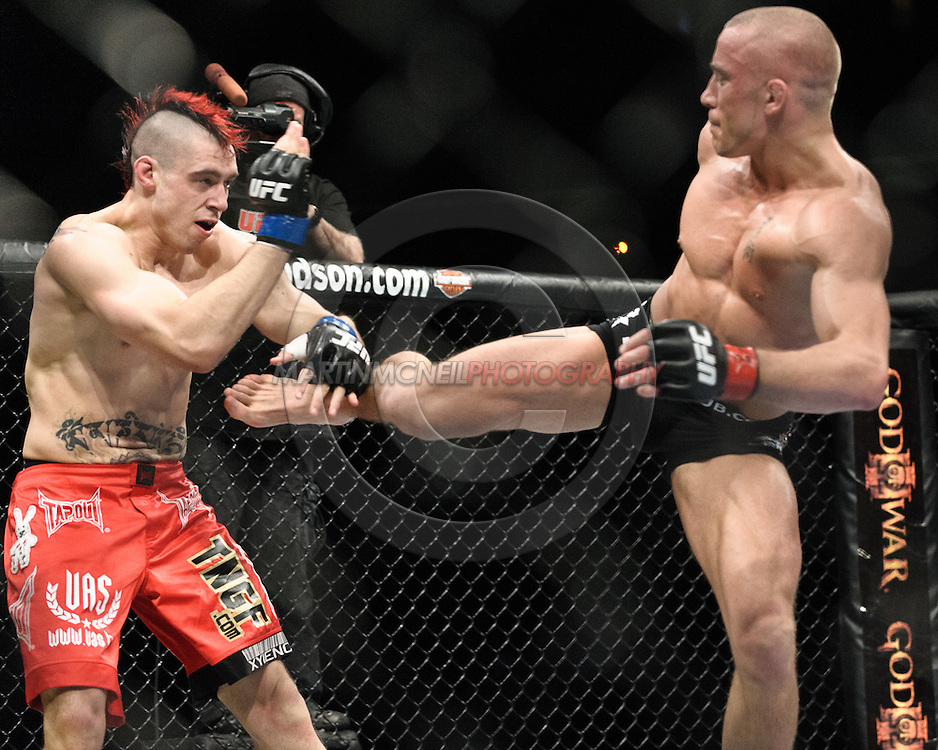 "NEWARK, NEW JERSEY, MARCH 27, 2010: Dan Hardy (left) and Georges St. Pierre are pictured during their bout at ""UFC 111: St. Pierre vs. Hardy"" in the Prudential Center, New Jersey on March 27, 2010"