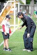 Kyle Mills teaching cricket fan, at the National Bank's Cricket Super Camp , University oval, Dunedin, New Zealand. Thursday 2 February 2012 . Photo: Richard Hood photosport.co.nz