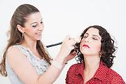 Make up artist and female model on white