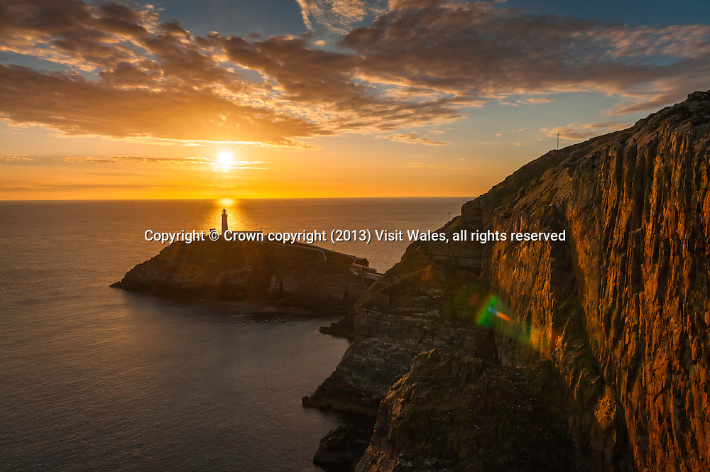 South Stack lighthouse at sunset<br /> Near Holyhead<br /> Anglesey<br /> North<br /> Coastal Scenery