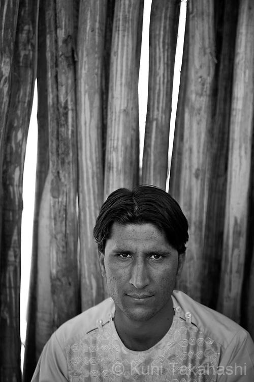 Sahar Udin, 27,  of suburban Kabul (originally of Bamian), wood dealer.in Kabul, Afghanistan on Aug 15, 2011..(Photo by Kuni Takahashi)
