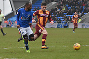 Bradford City forward Shay McCartan (14)  battles for possession  during the EFL Sky Bet League 1 match between Oldham Athletic and Bradford City at Boundary Park, Oldham, England on 3 February 2018. Picture by Mark Pollitt.