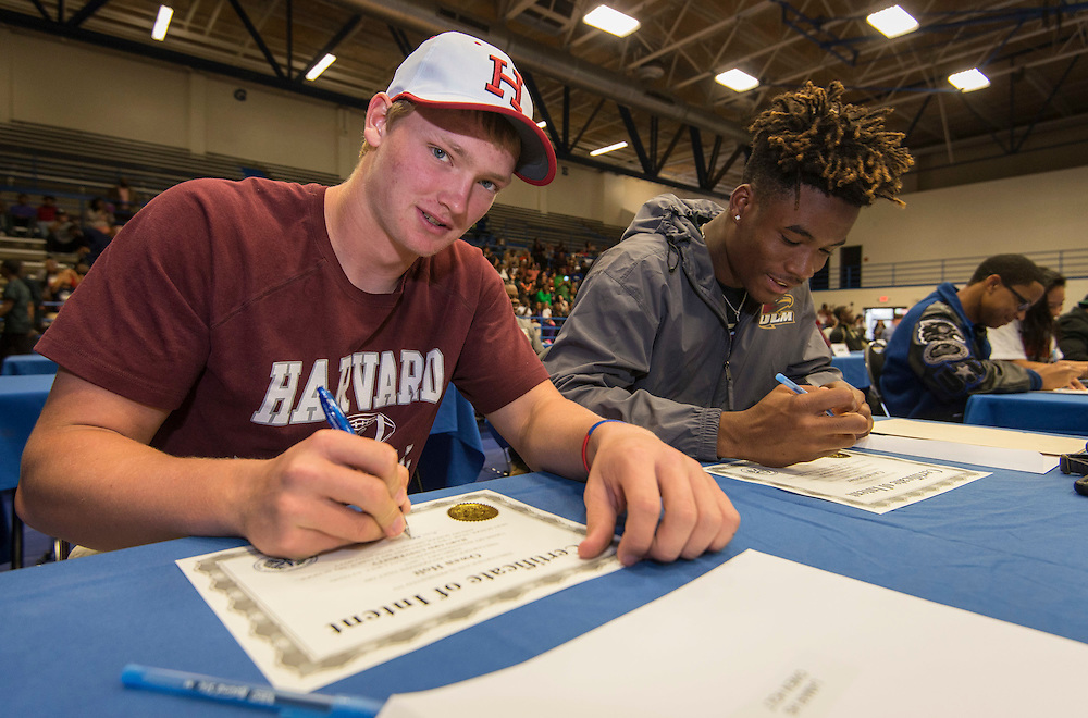 Lamar High School football player Owen Holt commits to Harvard during Athletic Signing Day at the Pavilion, February 1, 2017.