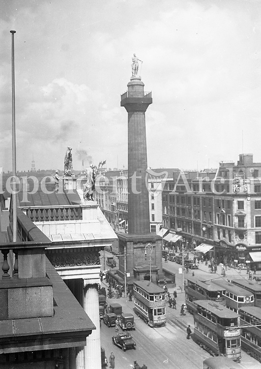 The GPO and the Nelson Pillar on Dublin's O'Connell St, 1920s. Originally built from 1808 to commmorate the British naval victory over the French at the Battle of Trafalgar, it was destroyed by a republican bomb in 1966. (Part of the Independent Newspapers Ireland/NLI Collection)