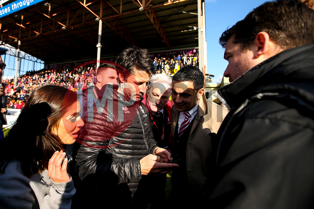 Lincoln City manager Danny Cowley looks to check whether his side have won promotion from Sky Bet League Two to Sky Bet League One - Mandatory by-line: Robbie Stephenson/JMP - 13/04/2019 - FOOTBALL - Sincil Bank Stadium - Lincoln, England - Lincoln City v Cheltenham Town - Sky Bet League Two