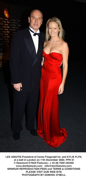 LEE AMAITIS President of Canto Fitzgerald Int. and KYLIE FLYN, at a ball in London on 11th December 2003.PPN 51