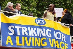 London, UK. 19 June, 2019. Ana Joaquim, an Aramark barista, addresses fellow outsourced catering, security, postal, porter and cleaning staff belonging to the Public & Commercial Services Union (PCS) and working at the Department for Business, Energy and Industrial Strategy (BEIS) via contractors ISS World and Aramark at a rally outside Parliament on the third day of continuing industrial action for the London Living Wage, terms and conditions comparable to the civil servants they work alongside and an end to outsourcing.