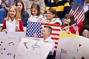 "15 JANUARY 2012 - PHOENIX, AZ:    Children wait for a family member to arrive at the The 161st Air Refueling Wing of the Arizona Air National Guard in Phoenix. About 100 soldiers of A (Alpha) Company of the 422nd Expeditionary Signal Battalion (referred to as ""Alpha 4-2-2"") of the Arizona Army National Guard returned to Arizona on Sunday, Jan. 15, following a nearly year-long deployment to Afghanistan. More than 10,000 Arizona Army and Air National Guard Soldiers and Airmen have been ordered to federal active duty in support of Operations Noble Eagle, Enduring Freedom, Iraqi Freedom, and New Dawn since September 2001. Approximately 200 Arizona National Guard Soldiers and Airmen are still serving on federal active duty overseas.  Photo PHOTO BY JACK KURTZ"