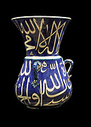 Mosque lamps.  Ceramic mosque lamps hung from the ceiling by chains.  Their shape is based on earlier glass examples fom Mamluk Egypt (AD 1250-1517).  It is likely that a glass oil lamp would have been fitted to provide light.  There is also a symbolic association of light with God.
