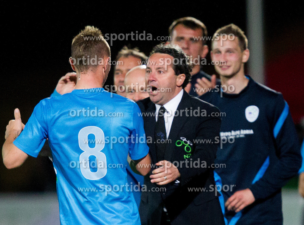 Jasmin Kurtic of Slovenia and Slavisa Stojanovic, head coach of Slovenia celebrate after Kurtic scored during friendly football match between national teams of Slovenia and Greece, on May 26, 2012 in Kufstein, Austria.   (Photo by Vid Ponikvar / Sportida.com)