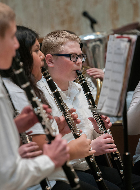 em020718e/a/Kimberly Madrid, second from left, Dylan McDonald, right, and others with the Cimarron School 7th and 8th grade band perform in the Rotunda of the State Capitol in Santa Fe, Wednesday February 7, 2018.  (Eddie Moore/Albuquerque Journal)