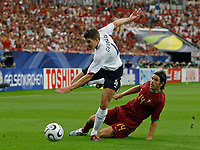 Photo: Glyn Thomas.<br />England v Portugal. Quarter Finals, FIFA World Cup 2006. 01/07/2006.<br /> England's Steven Gerrard (L) is tackled by Portugal's Nuno Valente.