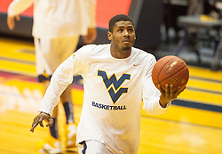 Jan 26, 2016; Morgantown, WV, USA; West Virginia Mountaineers forward Jonathan Holton (1) warms up before their game against the Kansas State Wildcats at the WVU Coliseum. Mandatory Credit: Ben Queen-USA TODAY Sports