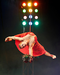 © Licensed to London News Pictures. 04/06/14 Fulham. UK. Tatiana Ozhiganova rehearsing her aerial strap routine for the Moscow State Circus which is performing at The Lillie Road Recreation Ground, Fulham, London on June 04 2014. This is Tatiana's first time in the UK. Performances run until the 8th June.. Photo credit : Arnaud Stephenson/LNP