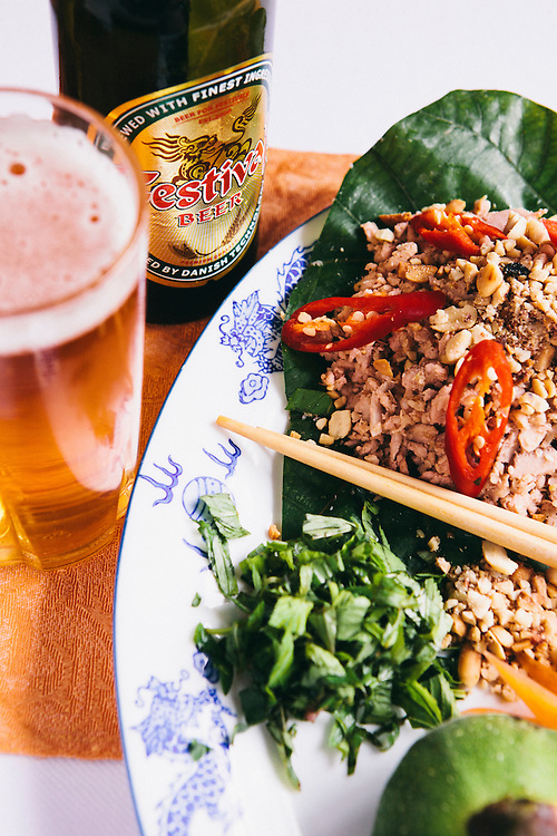 Mixed fig salad with pork and shrimp and Festiva beer at Y Thao Garden restuarant. Hue, Vietnam