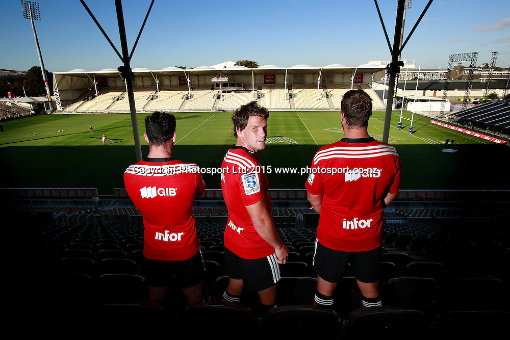 "Ryan Crotty of the Crusaders, Matt Todd and Wyatt Crockett pose wearing the Crusaders jersey with the new ""infor"" sponsors logo on the back at a Crusaders back Sponsor announcement of infor and Crusaders captains run training session held at AMI Stadium, Christchurch. 12 February 2015 Photo: Joseph Johnson / www.photosport.co.nz"