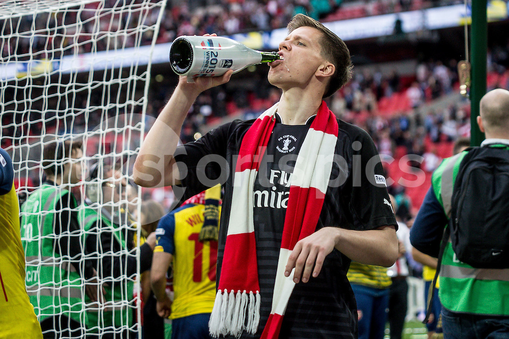 Goalkeeper Wojciech Szczesny of Arsenal drinks the champers after the The FA Cup Final match between Arsenal and Aston Villa at Wembley Stadium, London, England on 30 May 2015. Photo by Liam McAvoy.