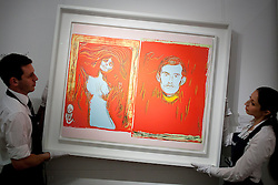 © Licensed to London News Pictures. 14/09/2012. LONDON, UK. Two members of Sotheby's staff adjust Andy Warhol's 'Madonna and Self Portrait with Skeleton's Arm (After Munch)' (1984) est. £200,000-300,000 as the New Bond Street auction house prepares for a sale of 'Old Master, Modern and Contemporary Prints'. The auction, set to take place on the 19th of September 2012, features nearly 200 masterful works artists including Andy Warhol, Lucian Freud and Francis Bacon. Photo credit: Matt Cetti-Roberts/LNP