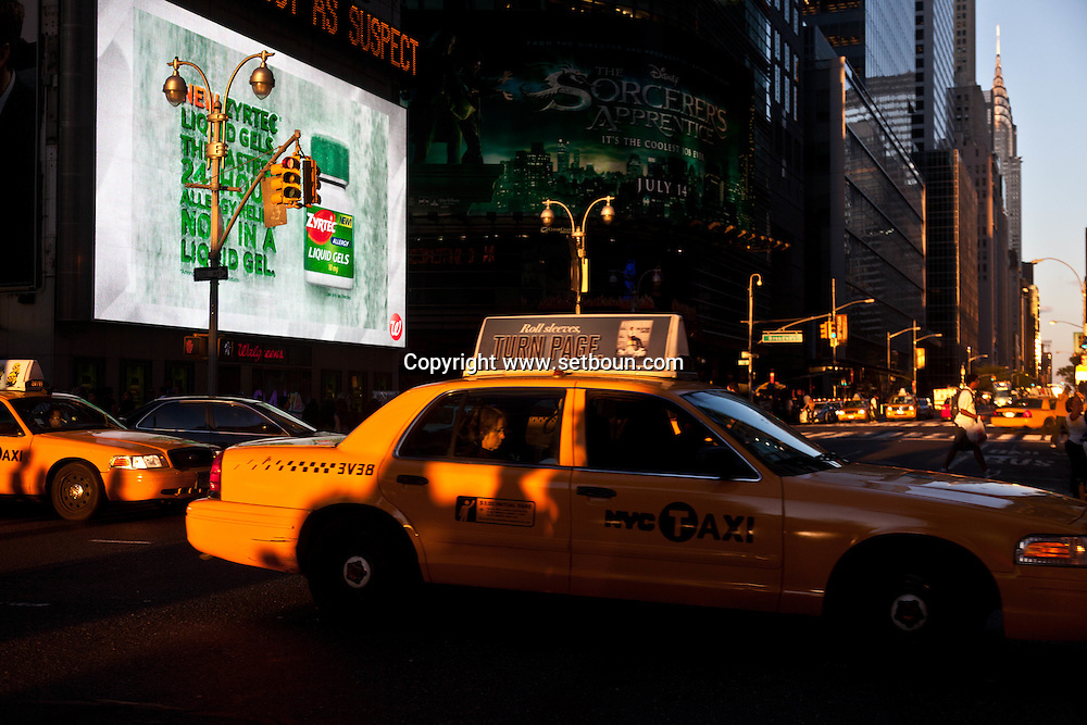 New York Times square, pedestrians shadows on yellow cabs at  sunset on 42nd street and broadway New york - United states