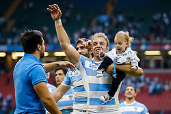 Argentina Number 8 Leonardo Senatore celebrates with his small child after Argentina win the match - Mandatory byline: Rogan Thomson/JMP - 07966 386802 - 18/10/2015 - RUGBY UNION - Millennium Stadium - Cardiff, Wales - Ireland v Argentina - Rugby World Cup 2015 Quarter Finals.