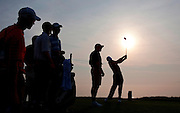 pga11, spt, lynn, 4.-Tiger Woods is sillouetted on the fourth tee as the sun rises over Lake Michigan during the second day of practice at Whistling Straits in Haven, WI Tuesday August 10, 2010.  Photo by Tom Lynn/TLYNN@JOURNALSENTINEL.COM