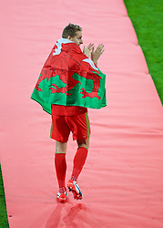 CARDIFF, WALES - Tuesday, October 13, 2015: Wales' David Edwards is presented to the supporters after qualifying for the finals following a 2-0 victory over Andorra during the UEFA Euro 2016 qualifying Group B match at the Cardiff City Stadium. (Pic by Paul Currie/Propaganda)