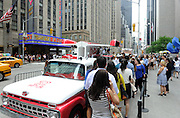 "Crowds enjoy free frozen treats at the unveiling of The Good Humor Truck during the launch of the Good Humor Welcome to Joyhood campaign, Thursday, June 25, 2015, in New York.  Follow @GoodHumor on Twitter as the Joy Squad travels to other cities this summer."" (Photo by Diane Bondareff/AP Images for Good Humor)"