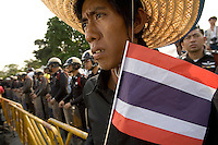 "BANGKOK, THAILAND  -  March 14: A man watches as tens of tousands of demonstrators seeking the resignation of Prime Minister Thaksin Shinawatra marched to government house on March 14, 2006 in Bangkok, Thailand. Marching several kilometers from the Grand Palace to Government House the protesters surrounded Thaksin's office chanting ""Thaksin Get Out"", as the Prime Minister threatened a state of emergency if the demonstration turned violent.  (Photo by David Paul Morris)"