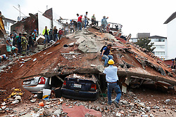 September 19, 2017 - Mexico City, Mexico - Independent search and rescue teams look for survivors under rubble on Racho el Arco St, in the south of the Capital Mexico City. The strong earthquake that struck Tuesday the City of Mexico caused the collapse of buildings in several points of the capital and left more than 200 people dead. An undetermined number of people are still trapped under debris. (Credit Image: © Luis Cortes/El Universal via ZUMA Wire)